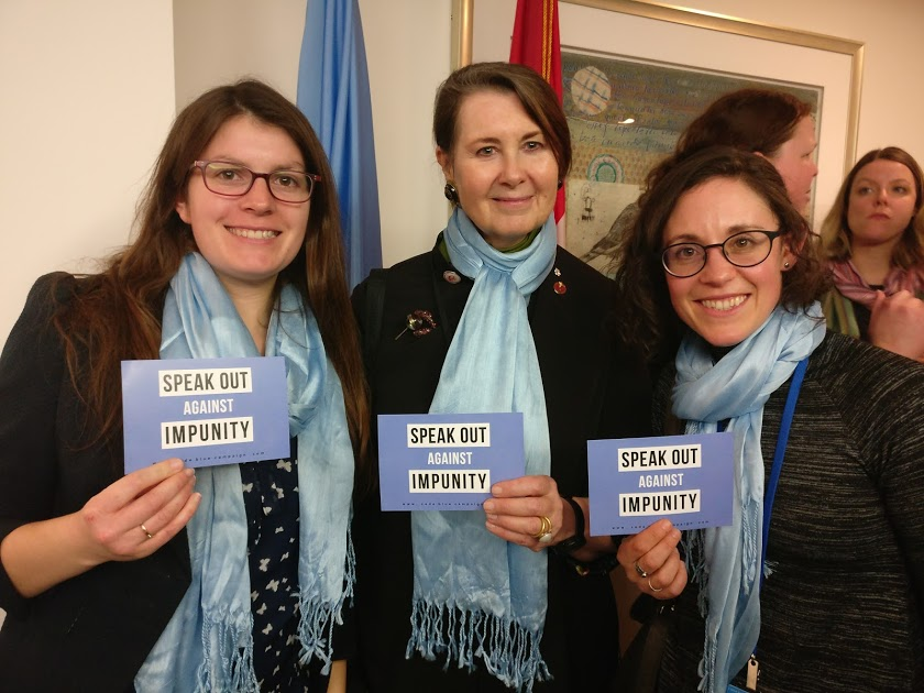Catherine Dunmore, LLM candidate at the University of Toronto's Faculty of Law, takes a photo with Senator Marilou McPhedran (centre) and Code Blue Coordinator Kaila Mintz (right) for Code Blue's scarf initiative. Photograph courtesy of the Code Blue Campaign.