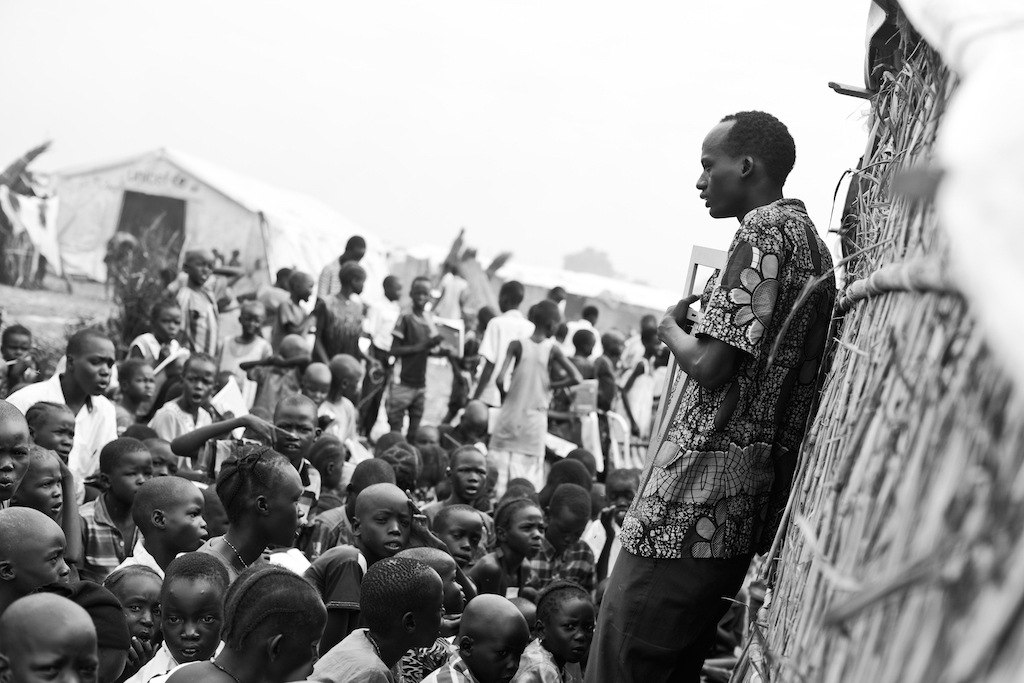 A math teacher in a Protection of Civilian site in South Sudan teaching boys and girls. Photography by Samer Muscati/Human Rights Watch.